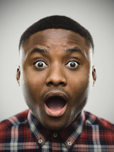 close-up portrait of shocked man - animal head stock pictures, royalty-free photos & images
