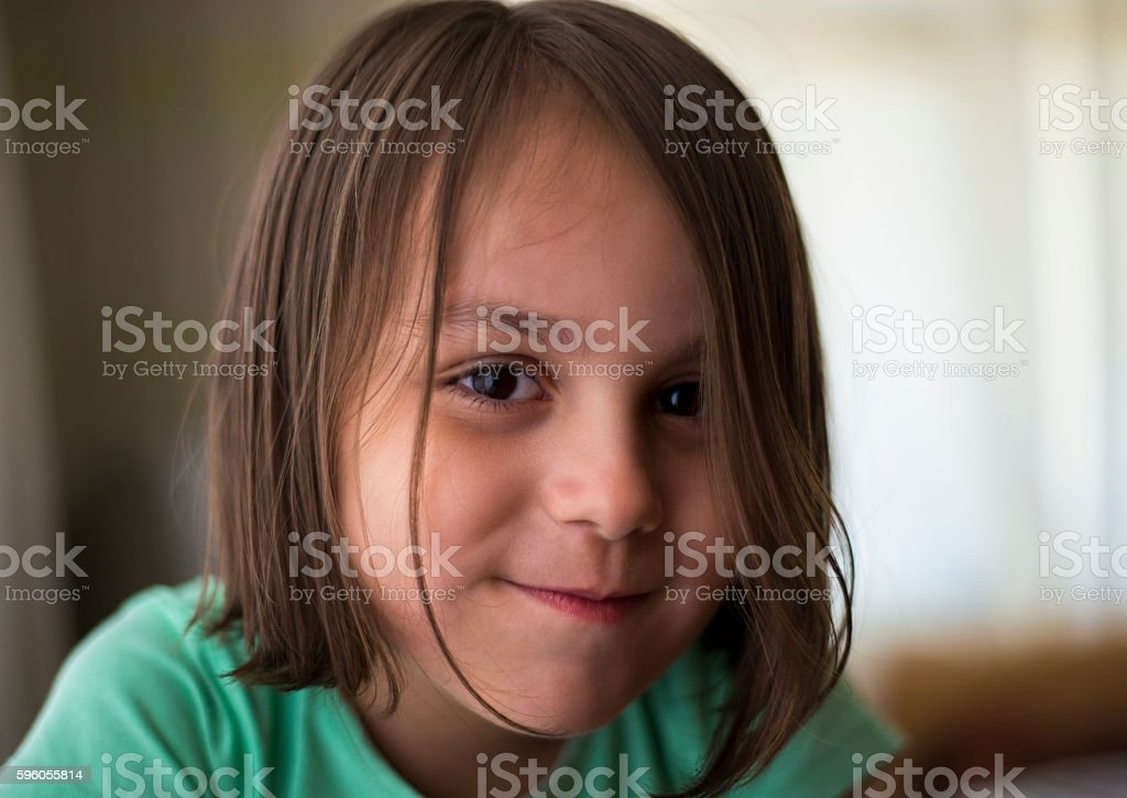 Close-up portrait of smiling little girl looking at camera royalty-free stock photo