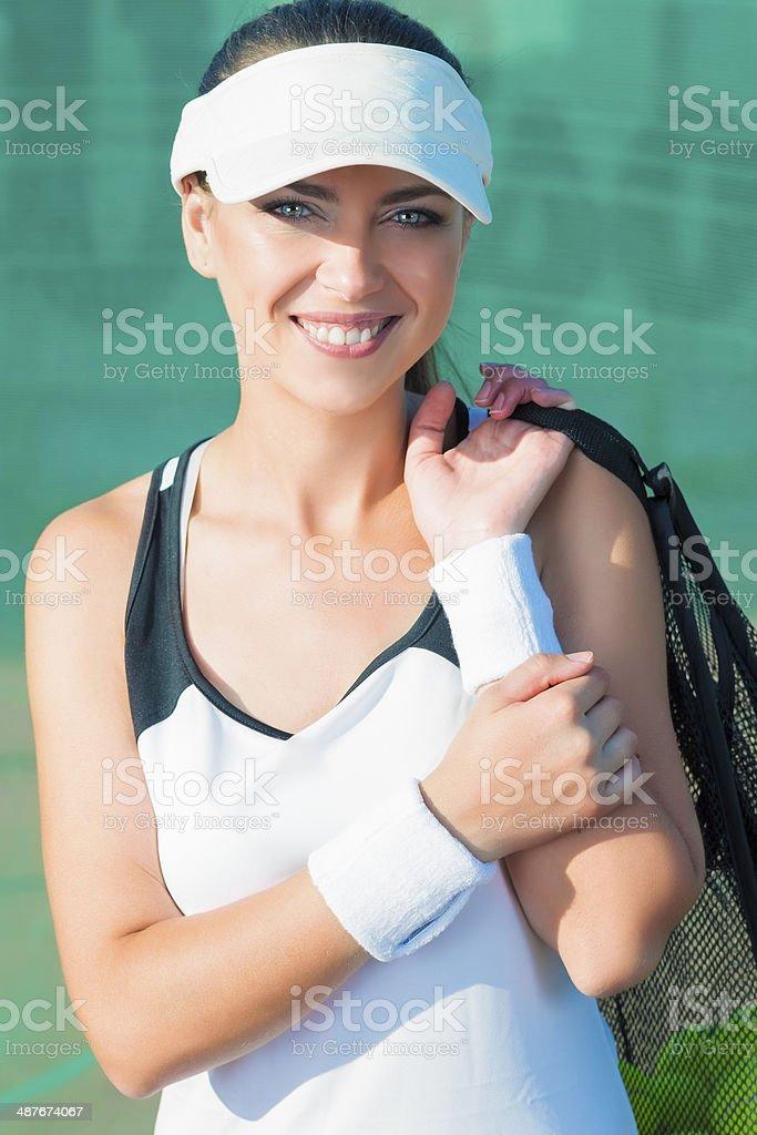 Smilling Female Tennis Woman Holding Tennis Mesh Bag with Balls....
