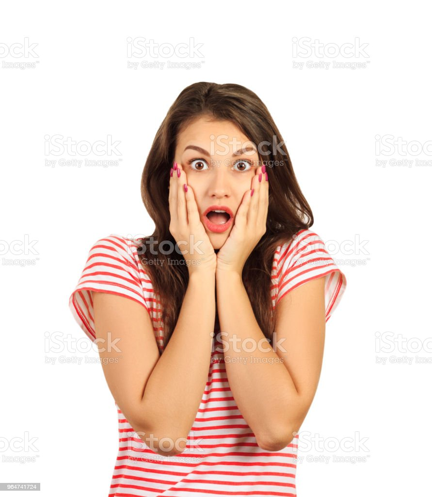 Close-up portrait of surprised beautiful girl holding her head in amazement and open-mouthed. emotional girl isolated on white background royalty-free stock photo