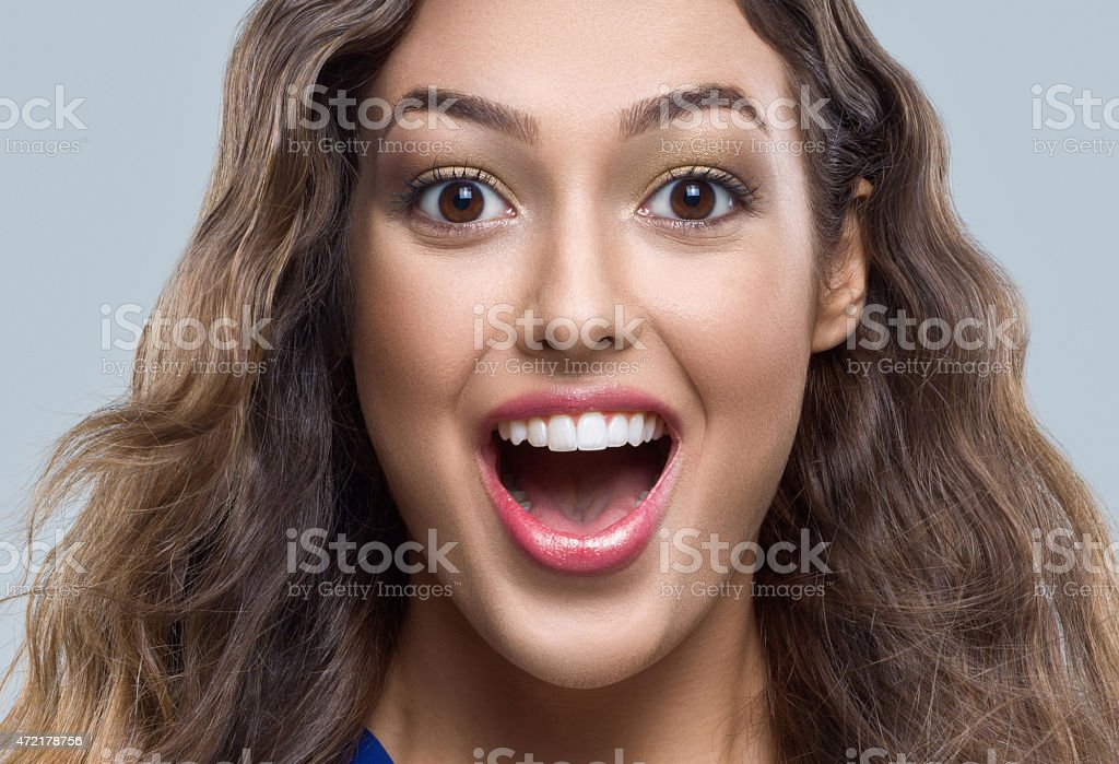 Close-up portrait of surprised young woman stock photo