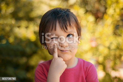 istock Close-up portrait of thinking little girl looking away with thoughtful facial expression 920706790