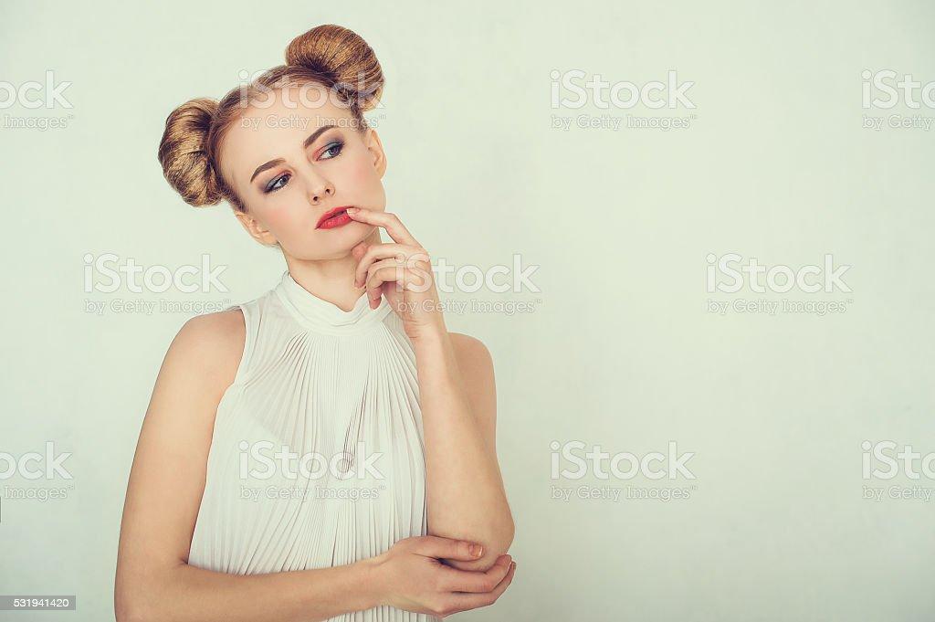 Close-up portrait of thoughtful beautiful girl stock photo