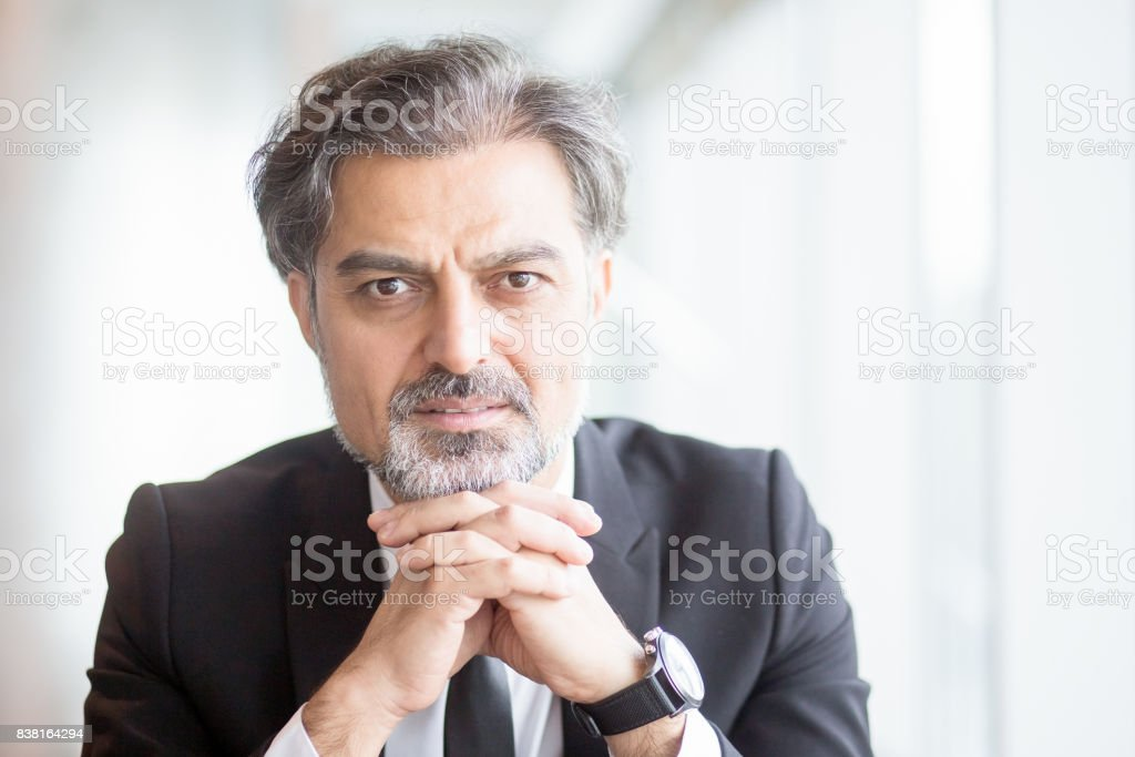 Closeup portrait of thoughtful middle-aged handsome business man...