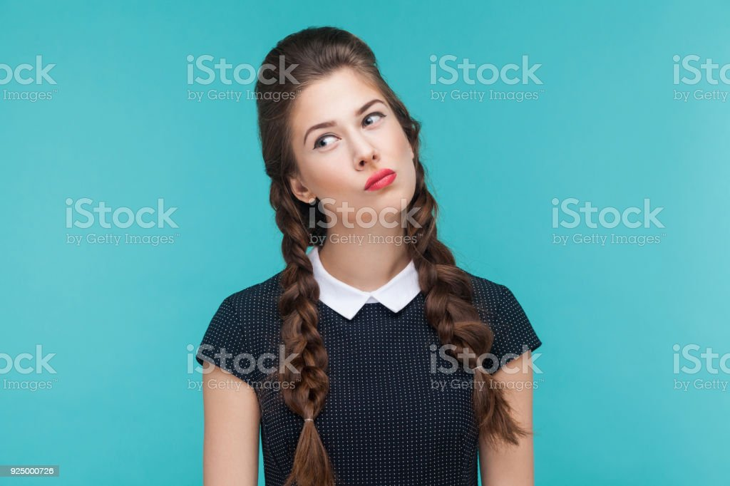 Closeup portrait of thoughtful woman looking up. stock photo