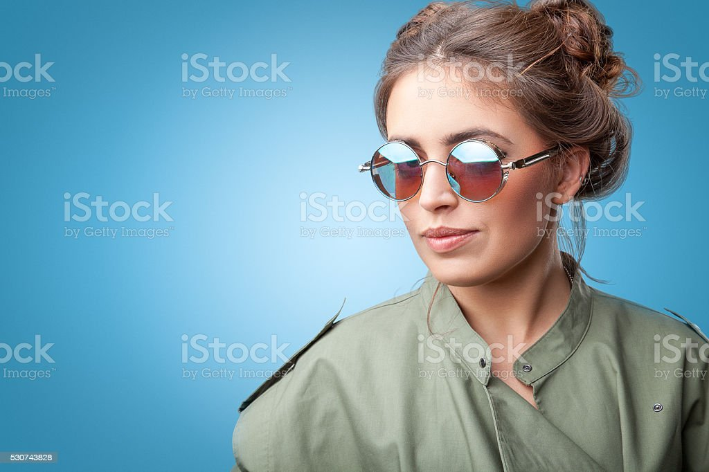 Closeup portrait of trendy hipster girl  posing at camera stock photo