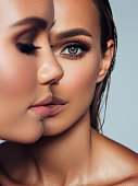 istock Close-up portrait of two beautiful girls 1279028273