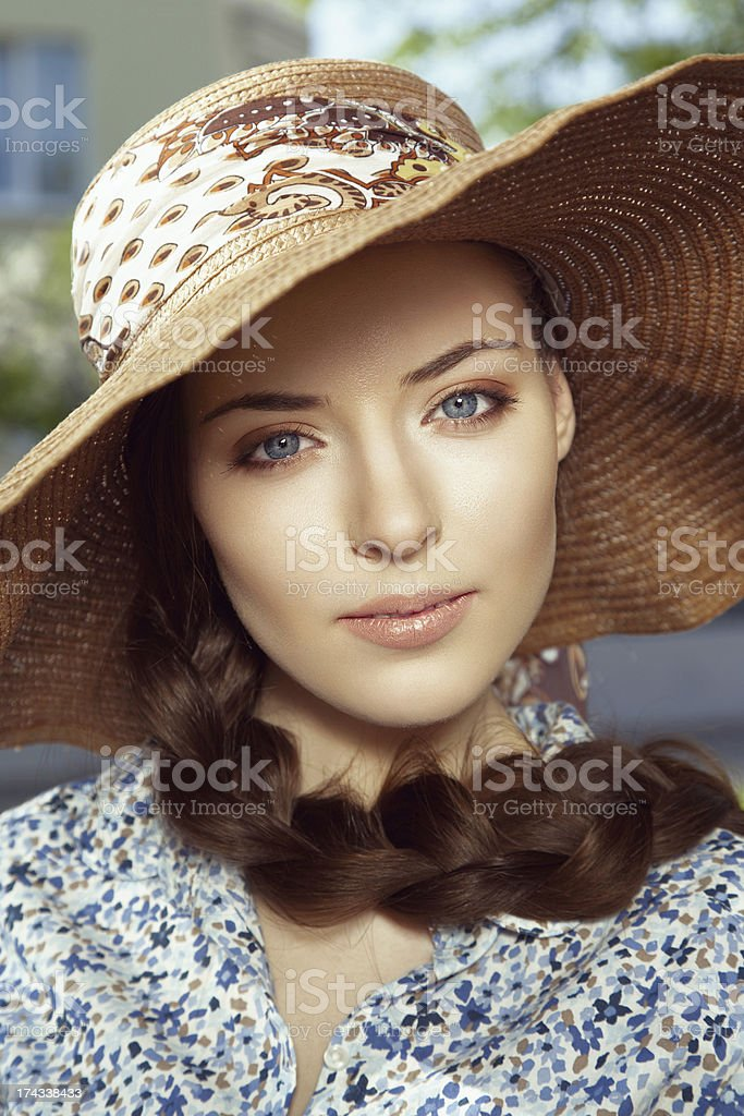 Close-up portrait of woman in hat stock photo