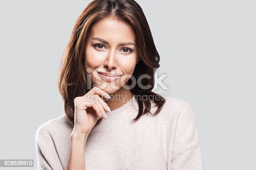 istock Close-up portrait of woman touching her face 628536910