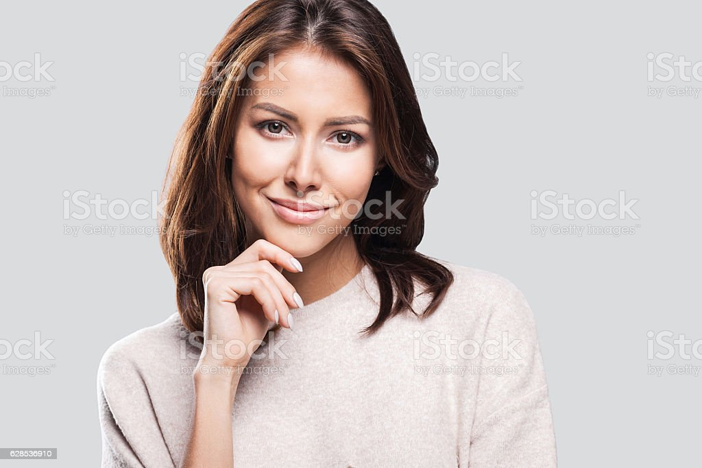 Close-up portrait of woman touching her face stock photo