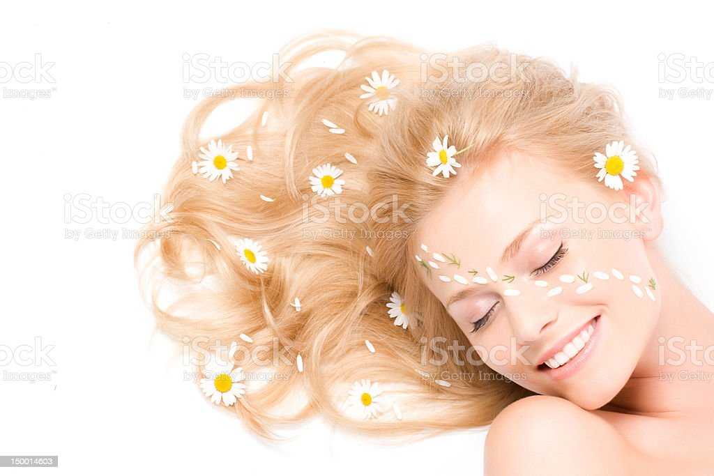 Close-up portrait of woman with camomile royalty-free stock photo