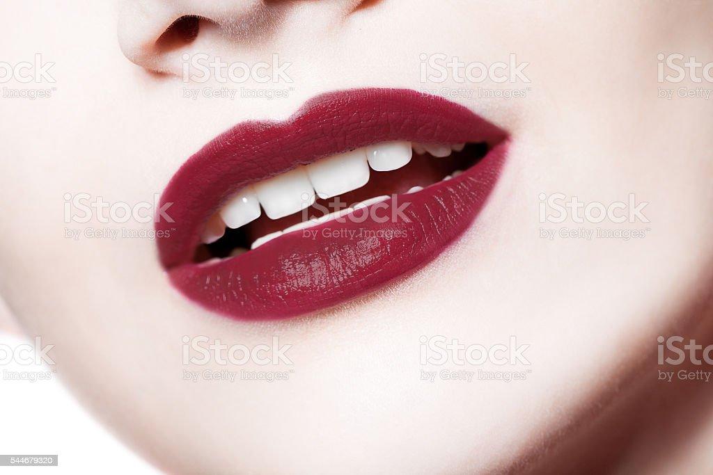 closeup portrait of  woman's  dark red lips stock photo