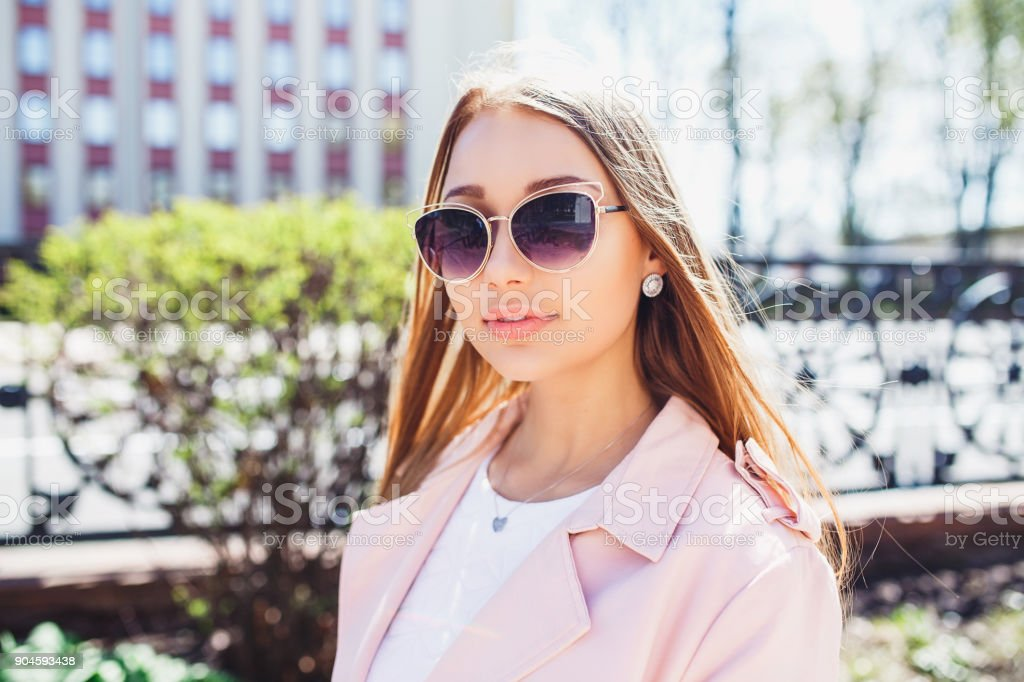 8813cbf212 Close-up portrait of young beautiful fashionable woman with sunglasses. Lady  posing outdoor - Stock image .