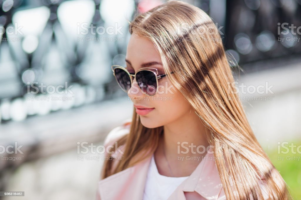 79a24ec524 Closeup portrait of young beautiful fashionable woman with sunglasses in  city. Lady posing outdoor - Stock image .
