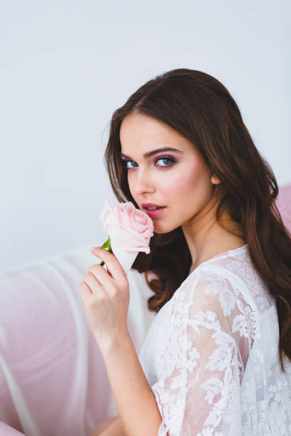 Close-up portrait of young beautiful model with rose stock photo
