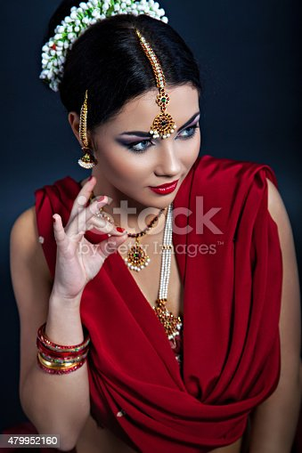 istock Closeup portrait of young beautiful woman in indian style 479952160