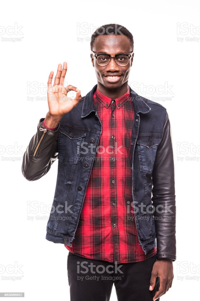 Closeup portrait of young handsome happy, smiling excited man giving OK sign with fingers, isolated on white background. Positive emotion facial expressions symbols feelings stock photo