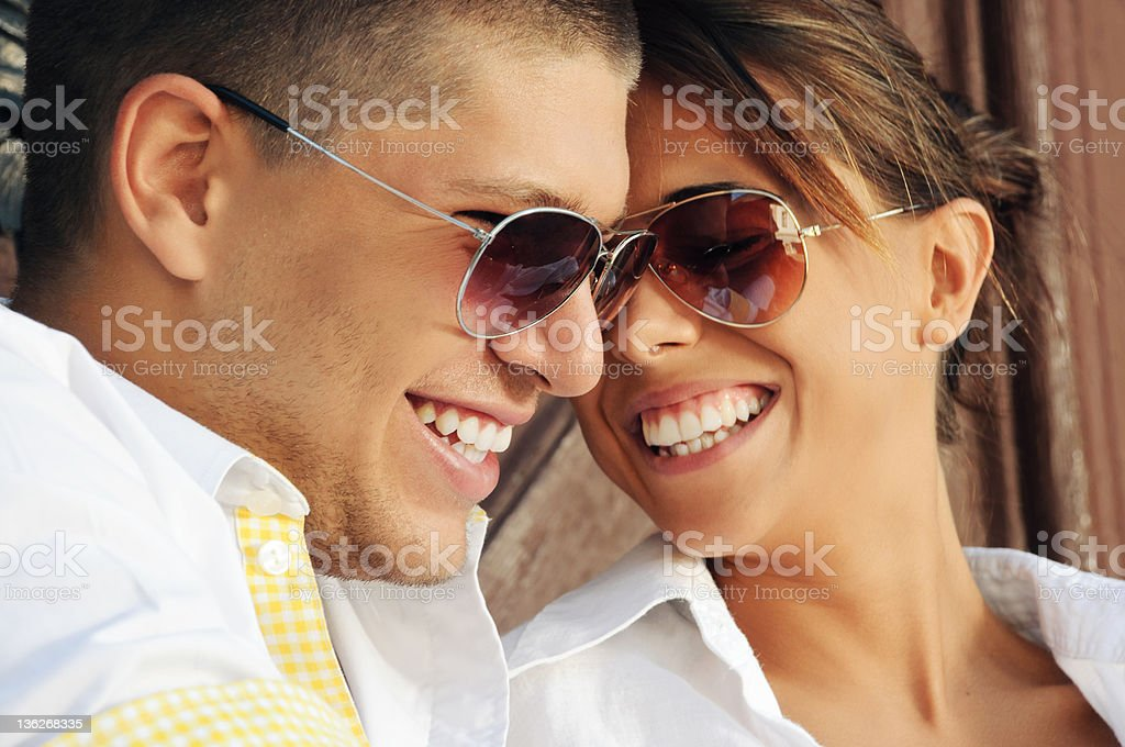 Closeup portrait of young happy couple with a toothy smile royalty-free stock photo
