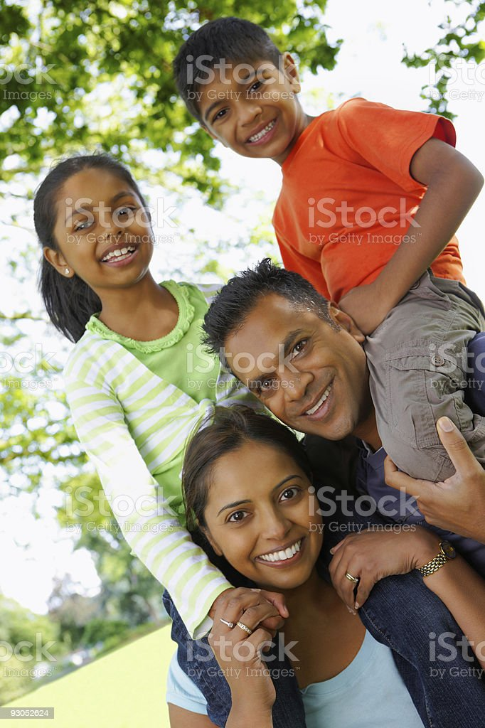 closeup portrait of young Indian Family having fun outdoors royalty-free stock photo