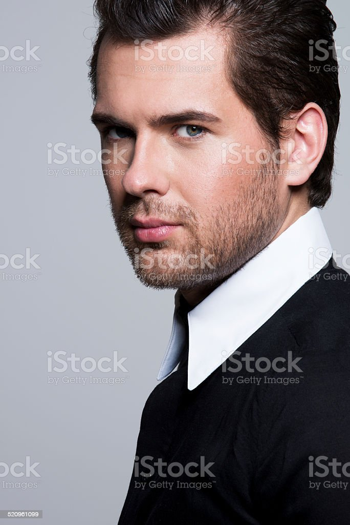 Close-up portrait of young man in black shirt. stock photo