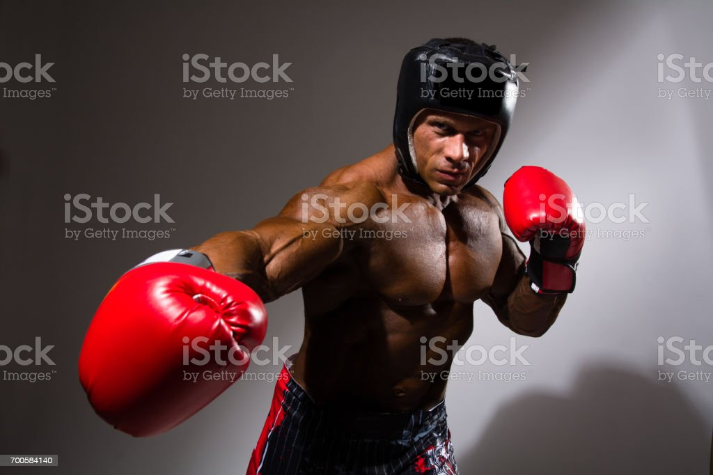Close-up portrait of young man with boxing helmet stock photo