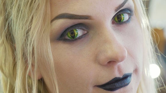 istock Close-up portrait of young pretty woman with halloween makeup at beauty salon 868823060