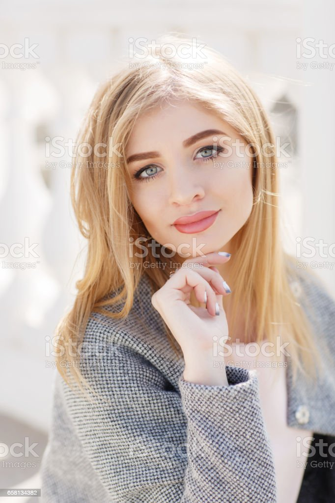 Closeup portrait of young woman posing on city street royalty-free stock photo