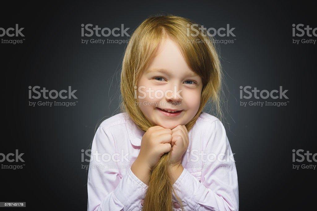 Closeup portrait shy girl isolated grey background stock photo