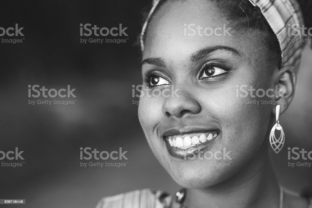 Close-up portrait young woman African clothing stock photo