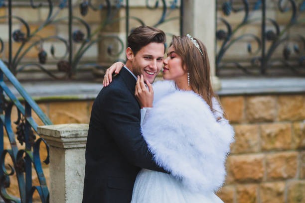 Close-up portraits of stylish newlyweds on the territory of country hotel stock photo