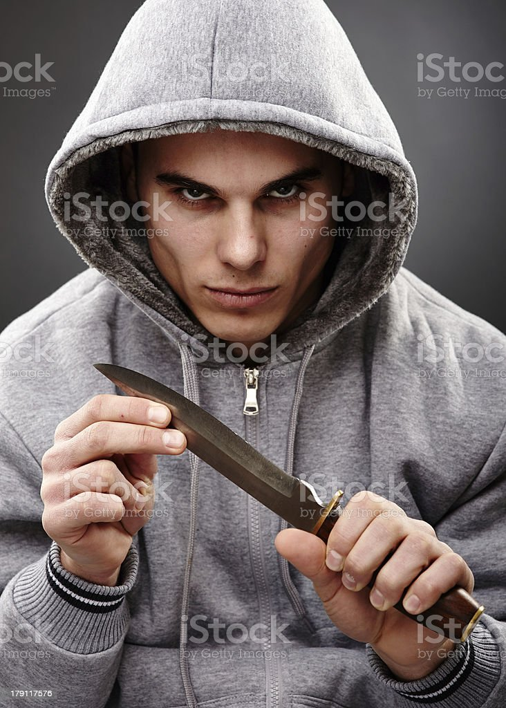 Closeup pose of a dangerous gangster royalty-free stock photo
