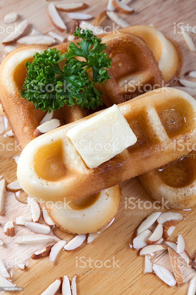 Close-up pour honey from top of waffles and nut stock photo