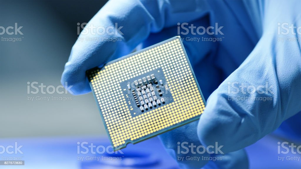 Close-up Presentation of a New Generation Microchip. Gloved Hand Holding Piece of Technological Wonder. stock photo