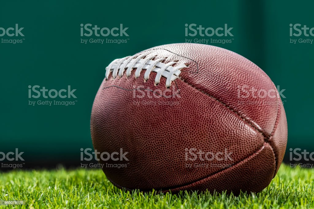 Close-up low angle view, of a textured pro American Football made of...