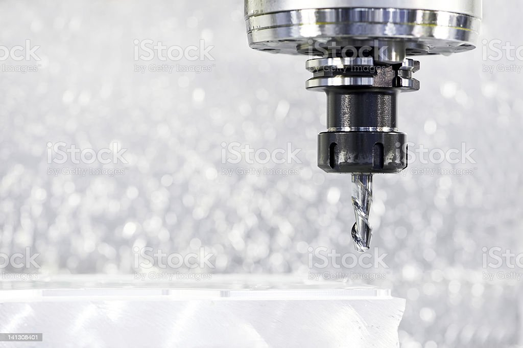 Close-up process of metal machining by mill royalty-free stock photo