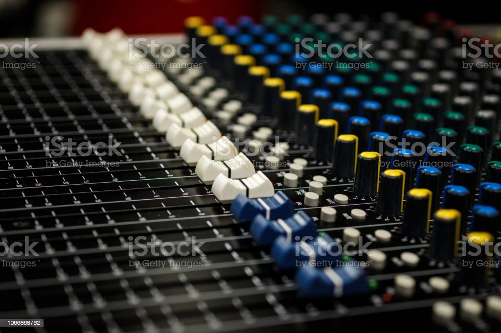 Professional Audio Sound Mixing Console Faders, black desk and white...
