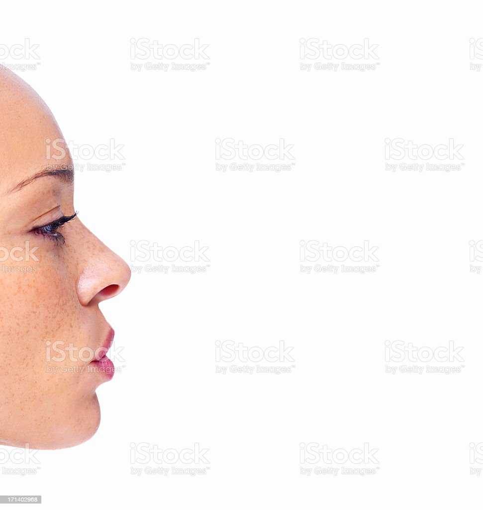 Closeup profile of a girl's face isolated on white background stock photo