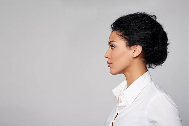 Closeup profile of business woman looking forward Closeup profile of confident business woman looking forward isolated on gray background side view stock pictures, royalty-free photos & images