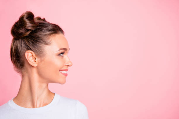 close-up profile side view of nice lovely cute fascinating attractive groomed cheerful cheery girl looking aside copy empty blank space place isolated over pink pastel background - beleza imagens e fotografias de stock
