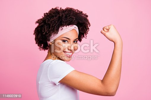 Close-up profile side view portrait of her she nice-looking attractive charming cute lovely powerful cheerful cheery wavy-haired girl showing muscles isolated over pink pastel background.