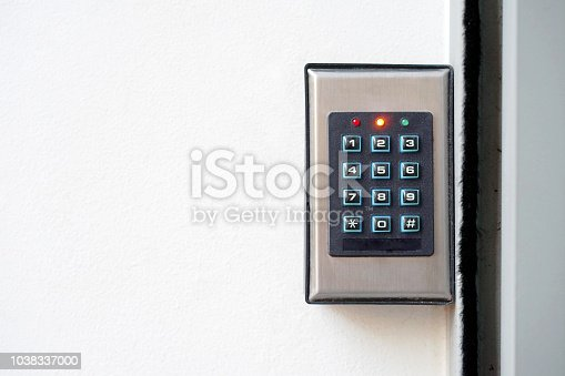 istock Close-up push-button lock of entrance doors 1038337000
