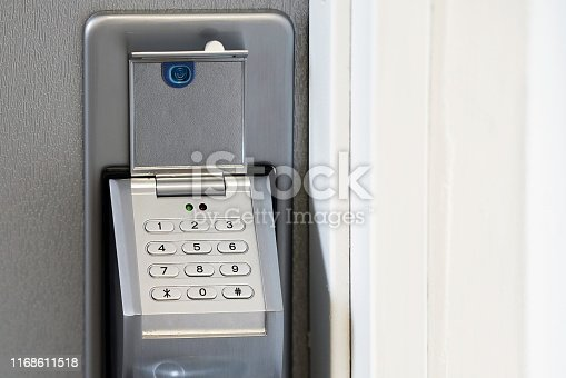 Door code in the handle of the entrance door to the apartment close-up. Secure password on keyboard for opening home house door. Password code Security keypad system protected in Public Building. The security code combination to unlock the door