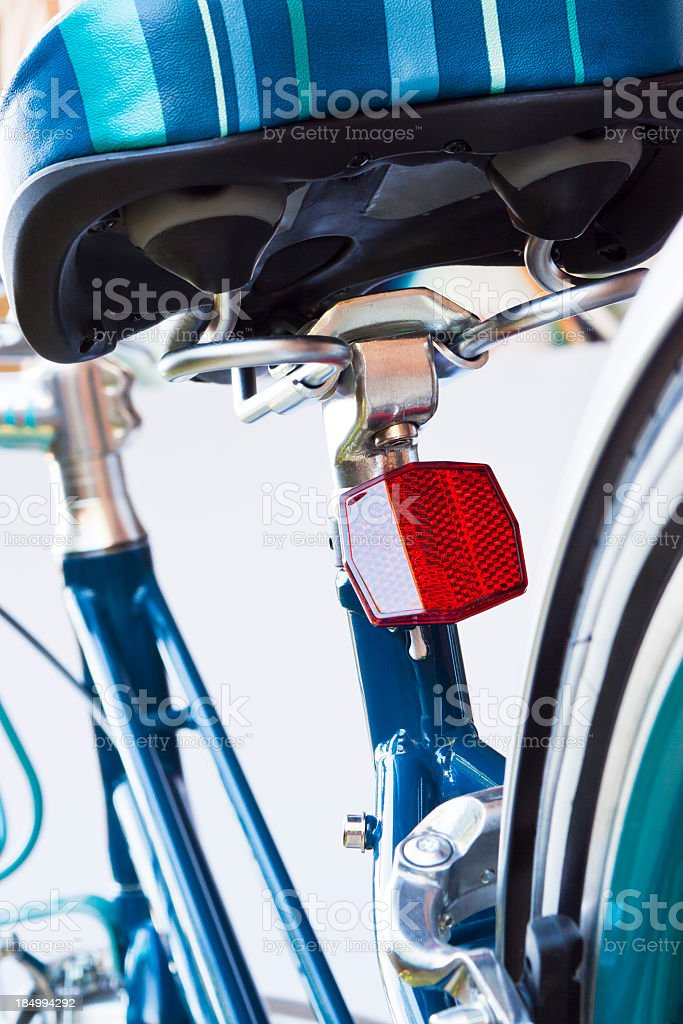 Closeup rear view of bicycle rear red reflector under seat royalty-free stock photo