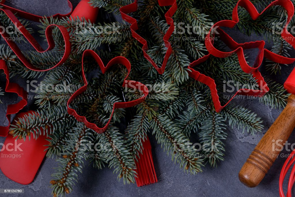 Closeup red cookies cutters and utensils stock photo