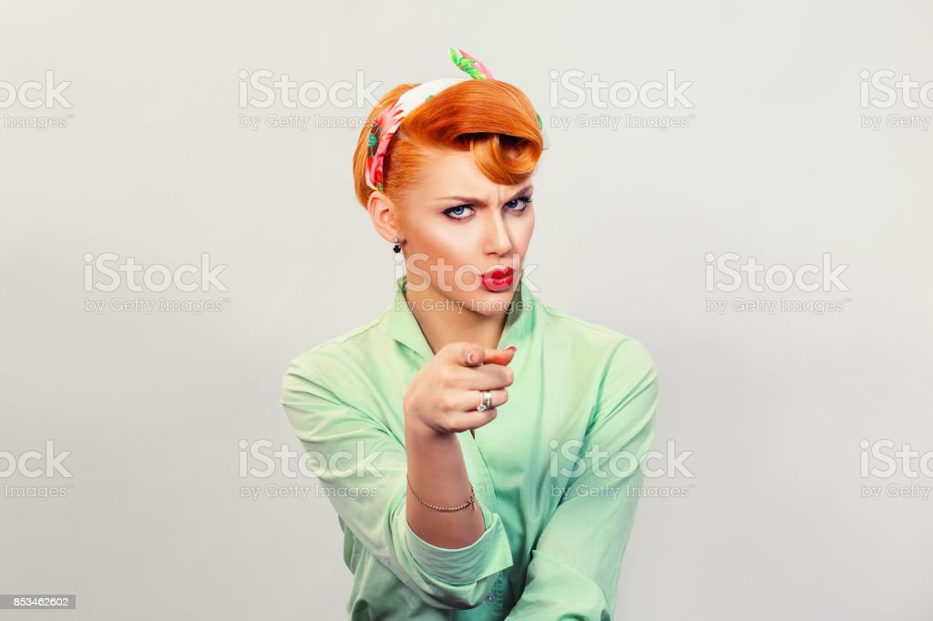 Closeup red head young woman pretty pinup girl green button shirt giving thumbs up sign gesture looking at you camera isolated white background retro vintage 50's style. Human emotions body language stock photo