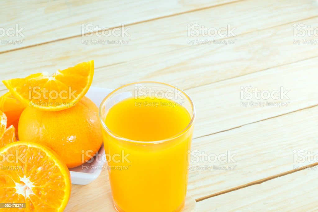 Close-up ripe orange on wood background. royalty-free stock photo