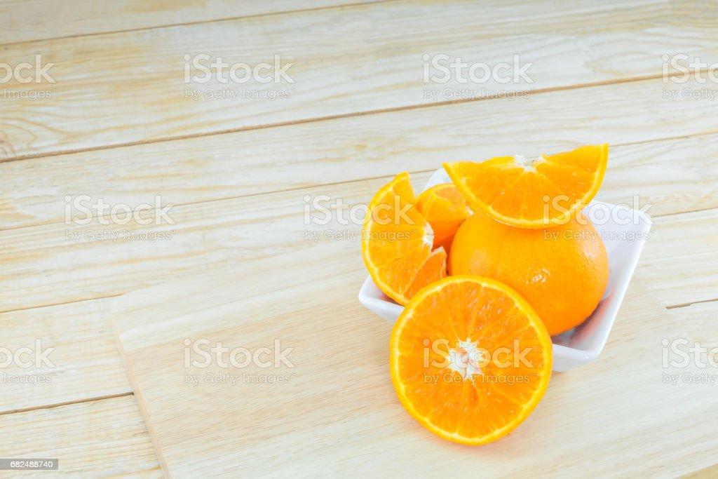 Close-up ripe orange on wood background. royalty-free stock photo