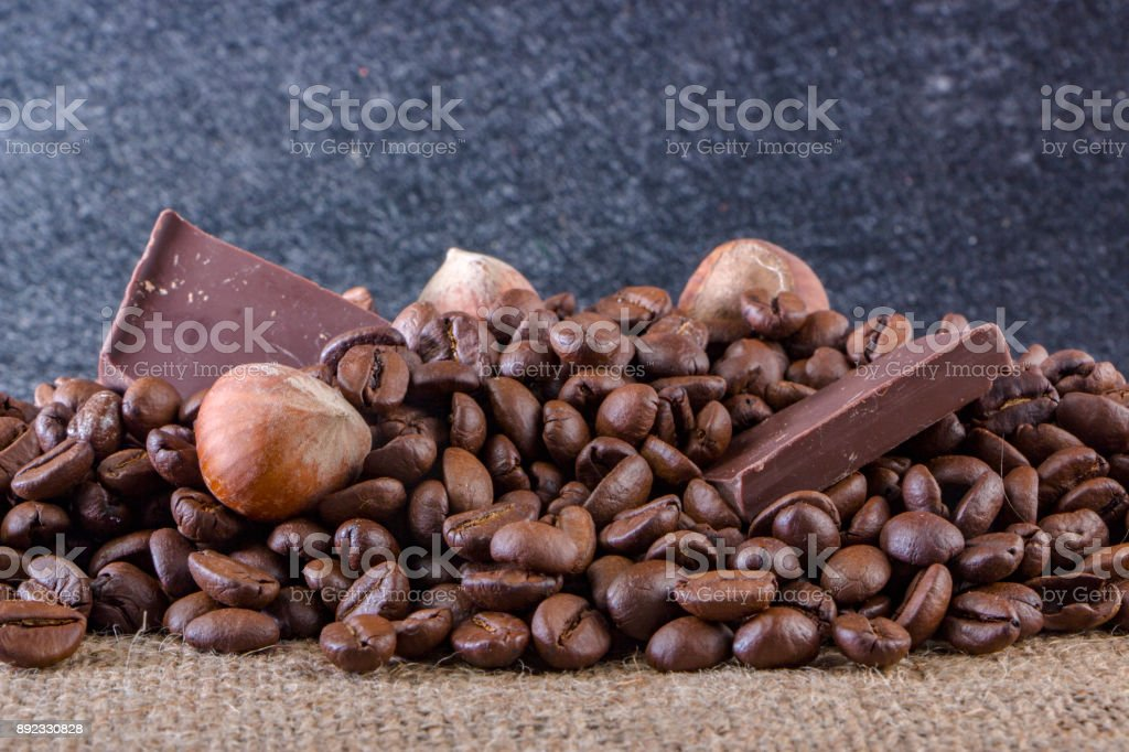 Close-up, roasted coffee seeds, tubberry, cinnamon sticks and chocolate. stock photo