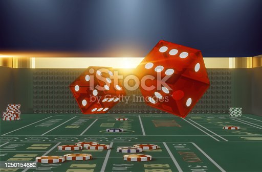 Close-up rolling dice on a craps table in casino
