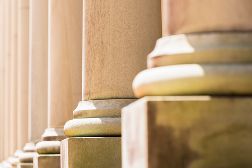 istock Closeup row of classical columns, background with copy space 636747266